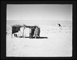 Primary view of object titled '[Men at Camp Site]'.