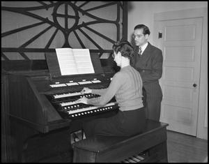 Primary view of object titled '[Man and Woman at Organ]'.