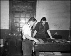 Primary view of object titled '[Two Men Typesetting at the Printshop]'.