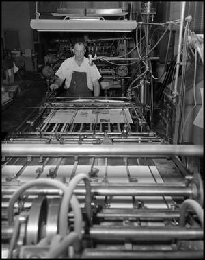 Primary view of object titled '[Man Working in Print Shop]'.