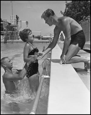 Primary view of object titled '[Lifeguard with Two Students Swimming}'.