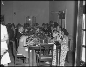 Primary view of object titled '[People Eating at a Formal Dinner]'.