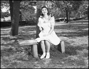 Primary view of object titled '[Polly Terrell Sitting on a Bench]'.