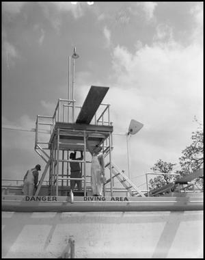 Primary view of object titled '[Men by Diving Board]'.