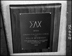 Primary view of object titled '[Photograph of an award from Sigma Delta Chi]'.