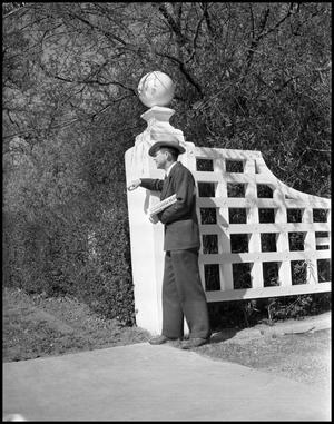 Primary view of object titled '[Dr. Shuford Standing by a Gate]'.