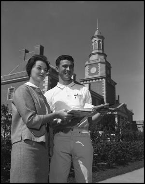 Primary view of object titled '[David Klement and Frances Braff in front of Administration Building]'.