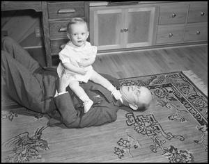 Primary view of object titled '[Photograph of Dr. Johnson with Baby]'.