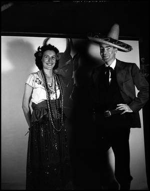 Primary view of object titled '[Dr. C.E. Shuford in a sombrero posing with unidentified woman]'.