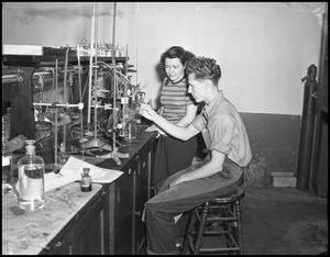 Primary view of object titled '[Photograph of Students in Lab]'.