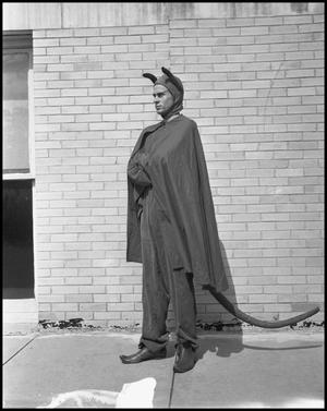Primary view of object titled '[Man in a Devil Costume]'.