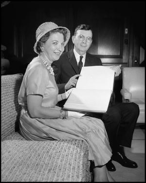 Primary view of object titled '[Dr. Matthews and Mrs. Myrtle Hollander with Book]'.