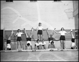 Primary view of object titled '[Women Doing Gymnastics]'.