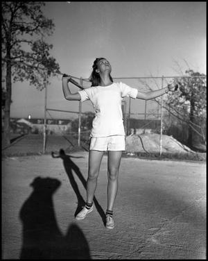 Primary view of object titled '[Female Student Playing Tennis]'.
