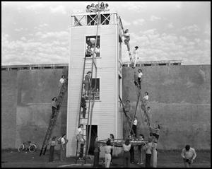 Primary view of object titled '[Students at Fire Safety Tower]'.