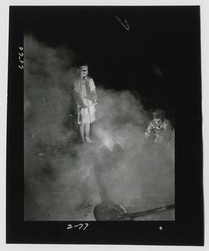 Primary view of object titled '[Young Boy and Girl Warming their Hands and Watching the Molasses Boil Down]'.