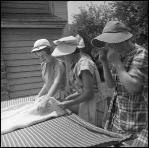Primary view of object titled '[Women quilting outdoors]'.