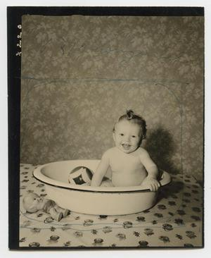 Primary view of object titled '[Douglas Clark taking a bath]'.