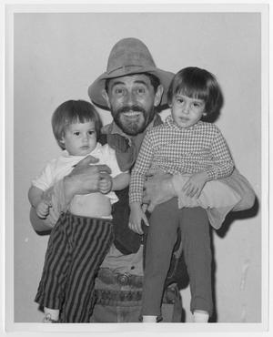 Primary view of object titled '[Ken Curtis with two children]'.