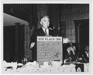 Primary view of object titled '[Rex Cauble speaking at Six Flags Inn]'.