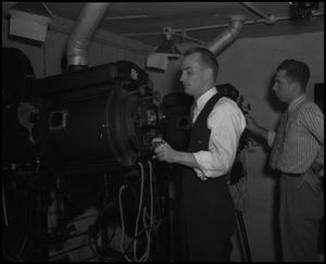 Primary view of object titled '[Two Men in a Projection Booth]'.
