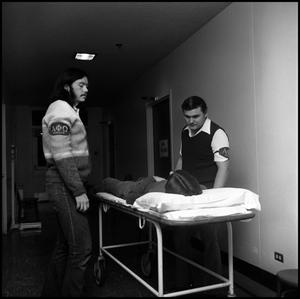Primary view of object titled '[Alpha Phi Omega members Harrison Gillum and Bill Marks on infirmary duty, 1973]'.