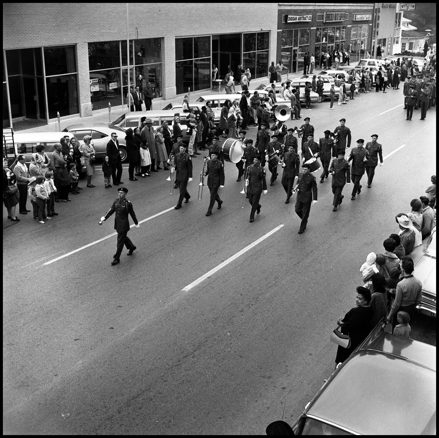 [AFROTC members march in the Homcoming Parade November 5, 1966]                                                                                                      [Sequence #]: 1 of 1