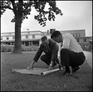 Primary view of object titled '[Dr. Farmer and Dr. Spurlock Reviewing Building Plans for the New Union]'.