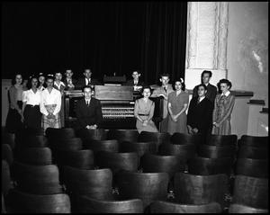 Primary view of object titled '[Students Gathered Around Organ]'.