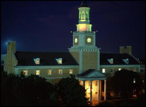 Primary view of object titled '[Administration Building at night from the northwest]'.