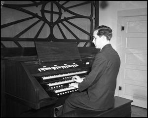 Primary view of object titled '[Man Playing Organ]'.