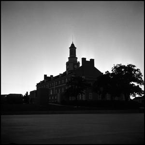 Primary view of object titled '[Administration Building from the southeast at dusk]'.