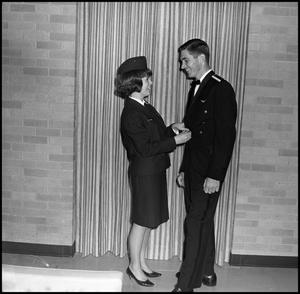 Primary view of object titled '[AFROTC and Angel Flight members prepare for the Military Ball]'.