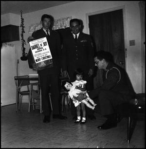 Primary view of object titled '[AFROTC members present a doll]'.