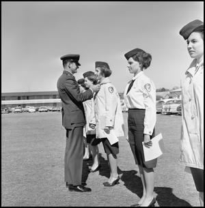 Primary view of object titled '[AFROTC event with members of Angel Flight]'.
