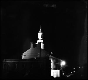 Primary view of object titled '[Administration Building from the southwest at night]'.