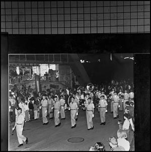 Primary view of object titled '[AFROTC Falcon Band in a parade, 1966]'.