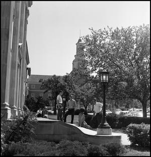 Primary view of object titled '[Students standing on the steps of the Library Building, with Administration Building in background]'.