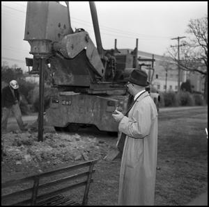 Primary view of object titled '[Dr. Wayne Adams at Construction Site]'.