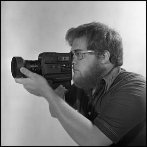 Primary view of object titled '[Film Maker and Producer Lewis Abernathy]'.