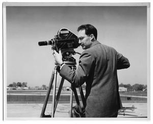 "Primary view of object titled '[Man Filming with ""Mag #1"" Camera]'."