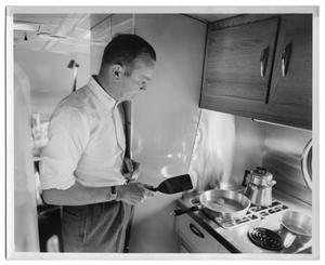 Primary view of object titled '[A Man Frying Eggs in the Kitchenette]'.
