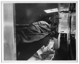 [A Long View Inside the Bus, With Sleeping Quarters and Kitchenette]