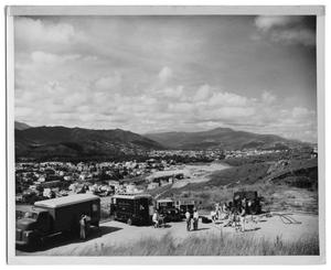 Primary view of object titled '[Princeton Film Center Vehicles Overlooking a Town in Venezuela]'.