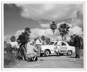 Primary view of object titled '[Shooting a Scene With a Man and a Car]'.