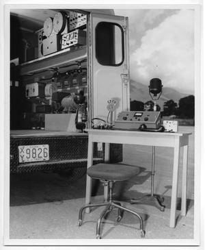 Primary view of object titled '[Sound Equipment Set Up Outside Custom Vehicle]'.