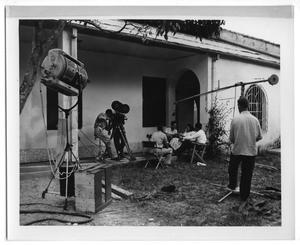 Primary view of object titled '[Filming a Scene Outside a Building]'.