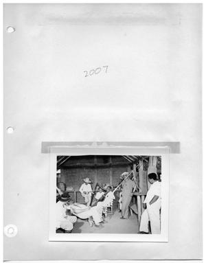 Primary view of object titled '[Missing] and [Eight Men Relaxing Inside with Harp and Hammock]'.
