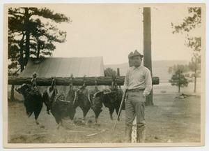 Primary view of object titled '[Man With a Rifle and Turkeys]'.