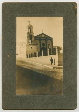 Primary view of object titled '[Man Walking Outside of a Church]'.